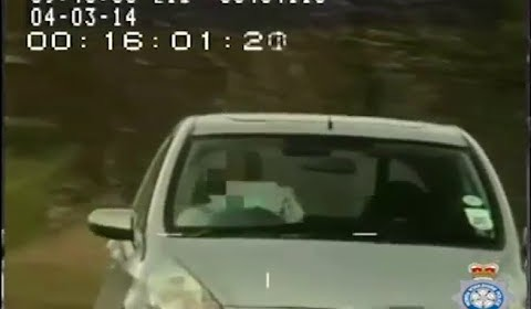 Driver Caught on Police Camera Reading Map While Driving