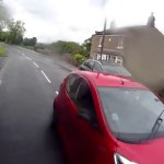 Road rage driver reverses at cyclist