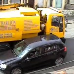 Truck smashes into parked car