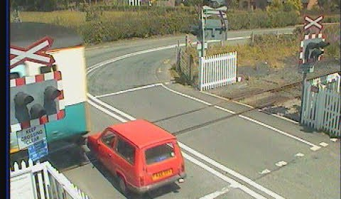 Reliant Robin Hit by Train At Level Crossing! FAIL