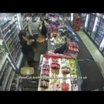 Shopkeeper fights off armed robber!