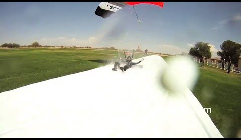 Ultimate slip and slide – skydivers swoop onto slip and slide