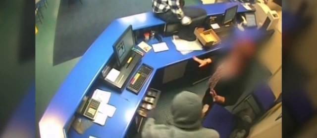 Pair of masked knife-wielding raiders rob bookies & threaten female staff