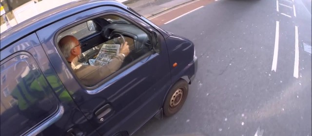 Cyclist Catches Van Driver Reading Paper Behind The Wheel